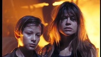 """No silvery cyborg better mess with her kid.  Linda Hamilton (with Edward Furlong) stars as Sarah Connor  in """"Terminator 2."""""""