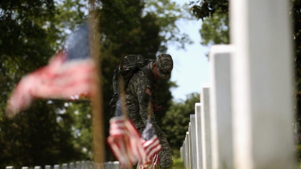 A small American flag was placed one foot in front of more than 220,000 graves at Arlington to mark Memorial Day.