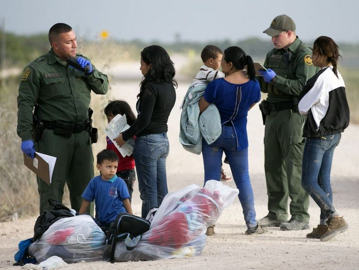 Some of a dozen women and children from Honduras are apprehended by Border Patrol near the Anzalduas International Bridge not far from the border with Mexico at the Rio Grande in Mission, Texas, on June 21.