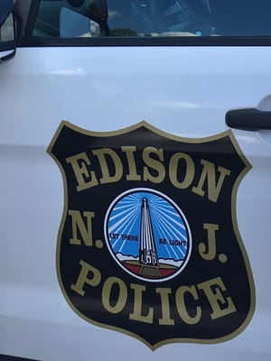 An Edison police officer who retired last year as part of a settlement with the township has filed a lawsuit to get his job back.
