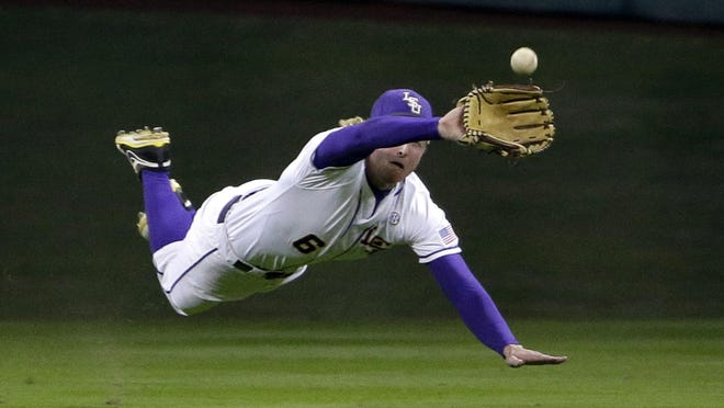 LSU center fielder Andrew Stevenson, shown here making a diving catch earlier this season, was selected late Monday night in the second round by the Washington Nationals.