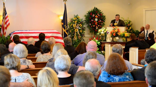 Wayne Foropolous speaks during the funeral service for A.B. Denton Wednesday at George A. Smith and Sons Funeral Home. Denton was a co-founder of Lynn Denton's Wrecker Service.