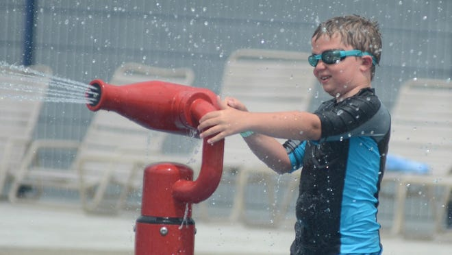 Corbin Hedrick, 9, blasts some summer watery fun during a July 6 to Kensington Metropark's Splash n' Blast water park. It was a good day to keep cool with temps in the lower 90s by mid-afternoon.