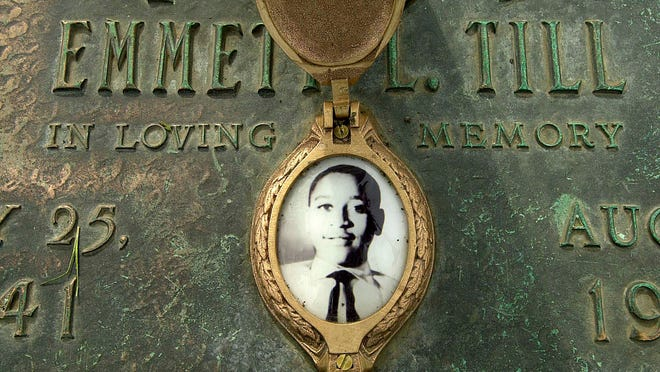 FILE - This May 4, 2005, file photo shows Emmett Till's photo on his grave marker in Alsip, Ill. Sixty-five years after 14-year-old Emmett Till was lynched in Mississippi, Congress is set to approve legislation designating lynching as a hate crime under federal law. The bill, named after Till, is intended to send a powerful message to confront violent racism and hatred that continues decades after the black teenager was murdered for allegedly whistling at a white woman.