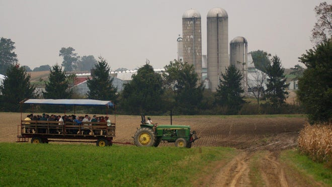 Members of the media are given a tour of the Rodale Institute's farm in Kutztown, Pa., where farming practices that retain carbon in the soil and help prevent global warming are researched.