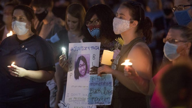 About 500 people, a large number of them white, listen to speakers during a candlelight vigil Thursday night at Gahanna City Hall. The vigil was to remember those who have lost their lives to police brutality.