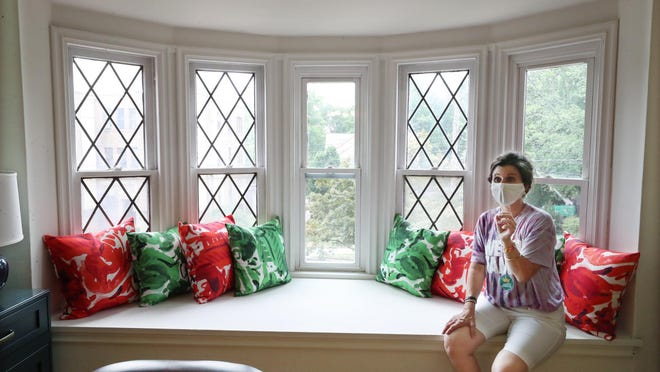 Michele Campbell, executive director of the LeBron James Family Foundation, sits in the window set of a two-bedroom apartment in the I Promise Village on Wednesday, July 22, 2020 in Akron. I Promise Village will serve as transitional housing for families of the I Promise School.