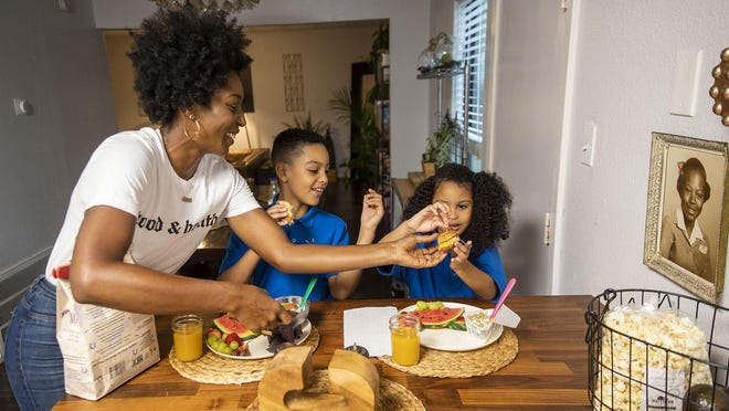 Robin Beltrán, seen here with her kids Liam and Penelope at their house in North Austin, didn't know any vegans when she switched her family's diet a few years ago because of her husband's health condition. They stopped eating meat and dairy as a family because he could no longer digest them, but the whole family saw positive mental and physical results.