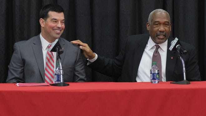Ohio State athletic director Gene Smith, right, and football coach Ryan Day at a news conference in December 2018 announcing Day's hiring as coach.
