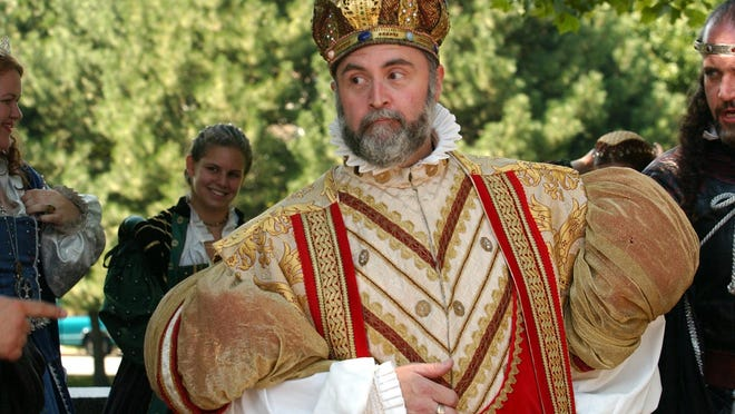 King Richard, left, aka Tom Epstein, performs with his fellow King Richard's Faire actors as they brought their show to Providence in 2003 to promote the annual event in Carver, Massachusetts.