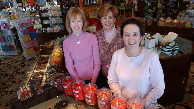 Photographed at their confection and gift shop 15 years ago are sisters Sheila Vinacco, Mary Lada, and Ann Ross. Now the three are  retiring after 26 years.