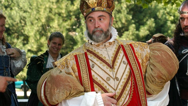 King Richard, aka Tom Epstein, performs with his fellow King Richard's Faire actors as they brought their show to Providence in 2003 to promote the annual event in Carver, Massachusetts.