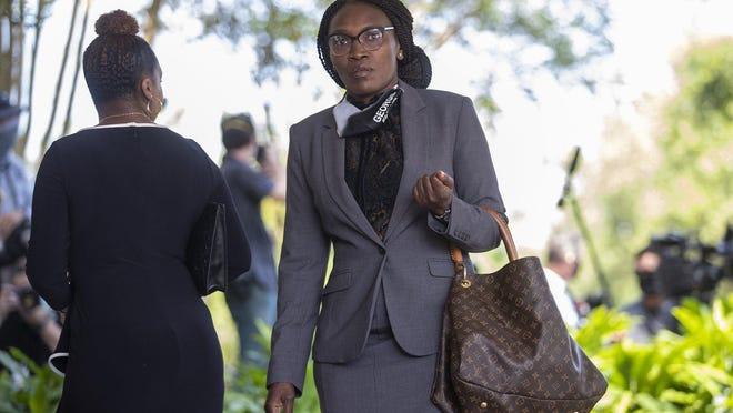 Wanda Cooper-Jones is the mother of Ahmaud Arbery, an unarmed 25-year-old African-American man who was fatally shot near Brunswick in Glynn County, Georgia, while jogging. Here she walks into to the private memorial of George Floyd at The Fountain of Praise church in Houston, Monday, June 8, 2020..