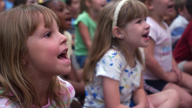 """Natalie Guillory, 5 (left), and Peyton Guillot, 6 (right) laugh during a 2005 performance of the """"Harvey Rabbit and Friends Show"""" at the Rapides Parish Library's Robertson Branch. A planned remodel of the branch in Tioga will include large children's and meeting areas for such events."""