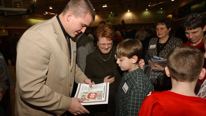 Unioto and Ohio State graduate Ben Hartsock, left, is shown at the Chillicothe-Ross Chamber of Commerce annual dinner in 2003, shortly after he and his Buckeye teammates won the BCS National Title over Miami. Hartsock was at the College Football Playoff Championship Game this week to support his alma mater.