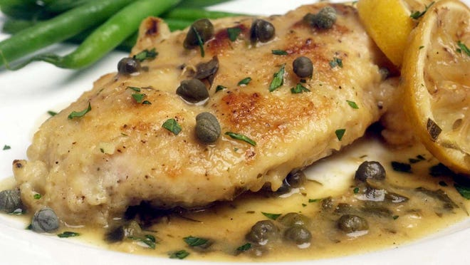 Chicken with capers and roasted lemons.