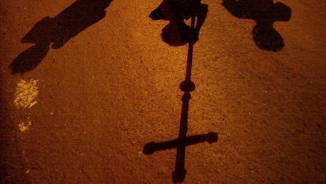 Catholic devotees carrying a crucifix during a Holy Week procession.
