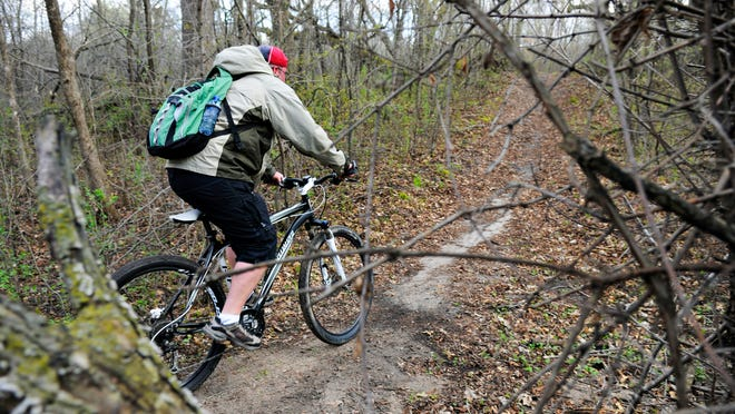 A cyclist cruises by on a new bypass <137>created by the Minnesota Off-Road Cyclists <137>May 15 at <137>the <137>Bertram Chain of Lakes Regional Park near Monticello. <137>Volunteers from MORC are working to reroute and rebuild a 10-mile mountain bike loop open to non-motorized use.<137>