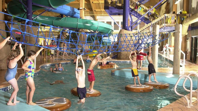 Children try crossing the water in the activity pool and play area at Tundra Lodge Resort-Water Park in Green Bay.