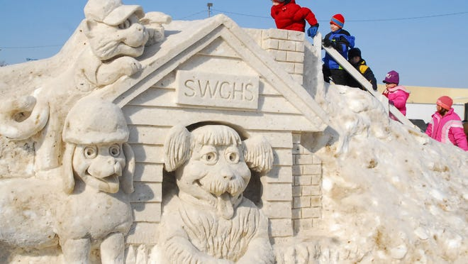 Children wait in line to go down a slide that is a part of the South Wood County Humane Society's snow sculpture in 2009. This year's event will be Saturday, Jan. 24.