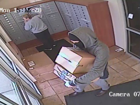 This is a 2017 file photo of a person caught on camera stealing packages from a Sartell apartment building.