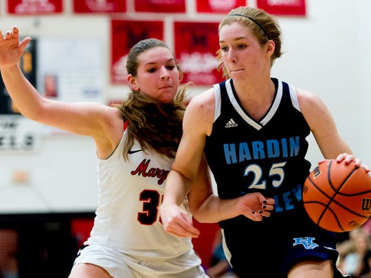 Hardin Valley's Abbey Cornelius (25) dribbles the ball past Maryville's Abby Young (30) during a game between Maryville and Hardin Valley at Maryville High School in Maryville, Tennessee on Thursday, January 11, 2018.
