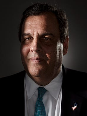 Republican presidential candidate Chris Christie poses