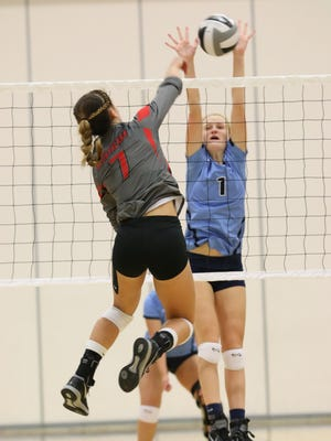 Adena's Lanie Shea blocks a kill attempt off the arm of Piketon's Cami Chandler. Shea's Warriors topped Chandler's Redstreaks in three sets Thursday night at Adena High School.