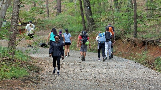 Hikers spend time on the trails at Crowders Mountain State Park on Monday.