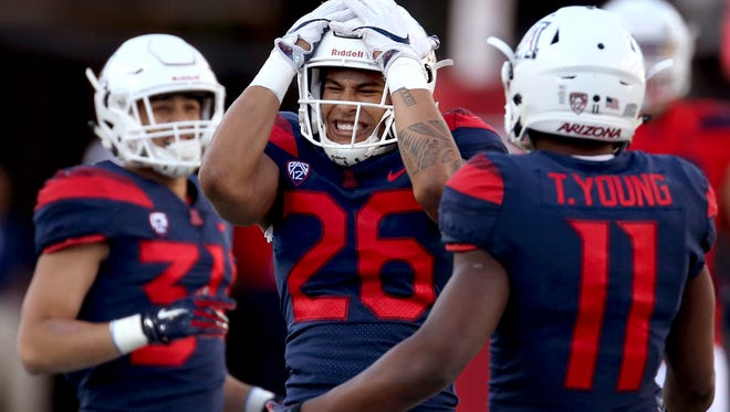 Linebacker Anthony Pandy reacts after narrowly missing coming up with an interception at the University of Arizona's spring game in Arizona Stadium, Saturday, April 14, 2018, Tucson, Ariz.