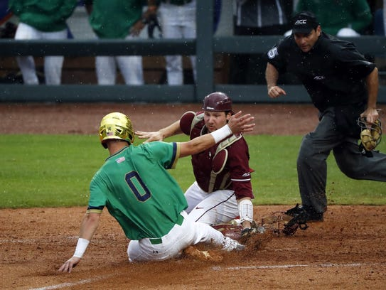 Florida State catcher Cal Raleigh tags out Notre Dame's