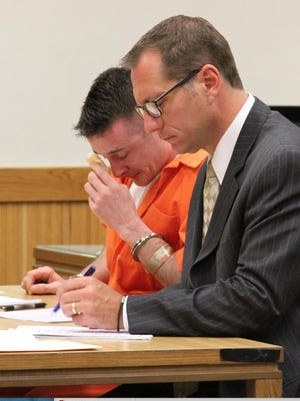 Anthony Duke,left, cries as he is sentenced in October 2015 in Livingston County Circuit Court to life in prison for murdering Ronald Hauser in 2011.