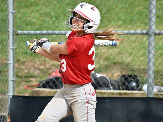 Fannett-Metal's Morgan Ritchey watches her hit fly into the air during a SHL/ICC game against Forbes Road on Wednesday, April 19, 2017 in Hustontown. Forbes Road won 2-1.