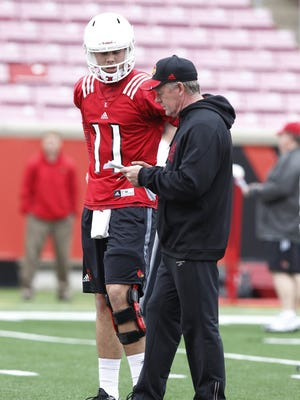 University of Louisville head coach Bobby Petrino talks with quarterback Will Gardner on Tuesday during the first day of the Cardinals' spring practices at Papa Johns Cardinal Stadium.
