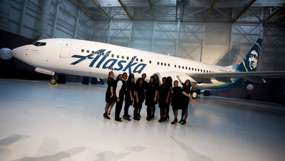 Crews pose with a Boeing 737 painted in Alaska Airlines'