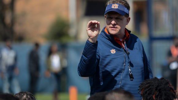 Auburn head coach Gus Malzahn speaks to the team during spring football practice on Saturday, March 4, 2017 in Auburn, Ala.