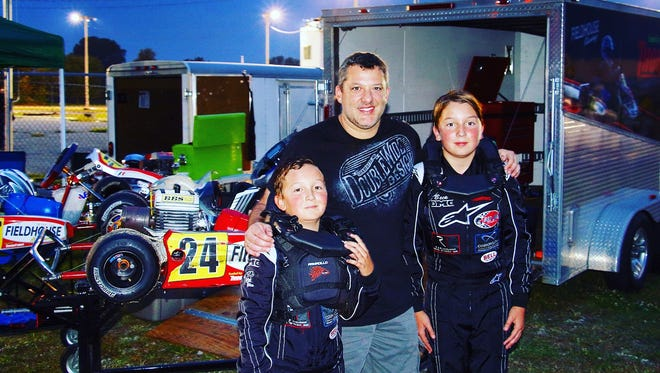 Ried fieldhouse, left, and brother Beck, right, with NASCAR driver Tony Stewart.