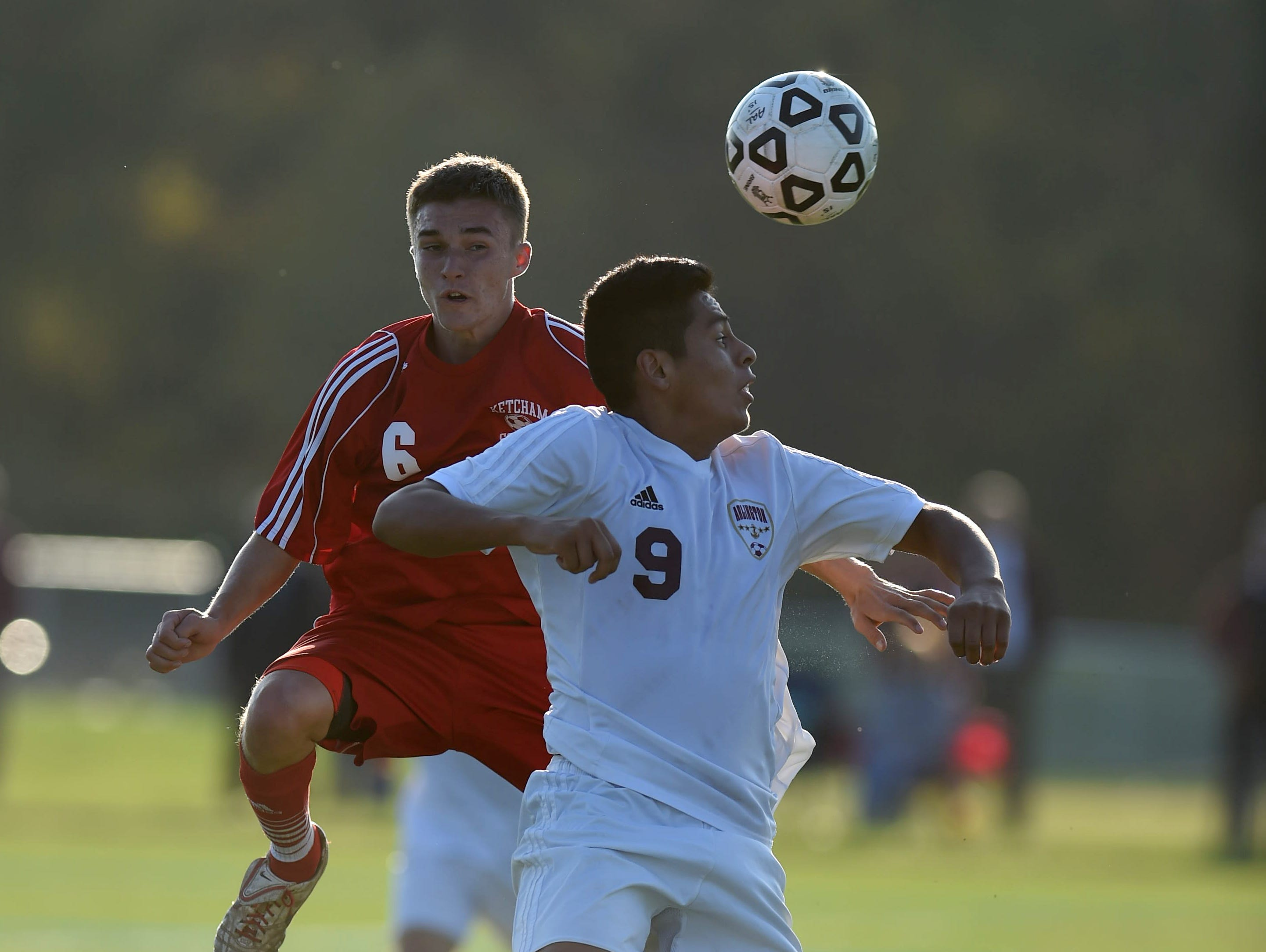 Arlington's George Pogo goes up for a header against Ketcham's Matt Lynch during Tuesday's game in LaGrangeville.