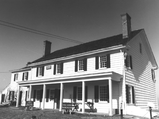 A photograph of the Shoal Harbor Museum from its 1974 application to the National Register of Historic Places.
