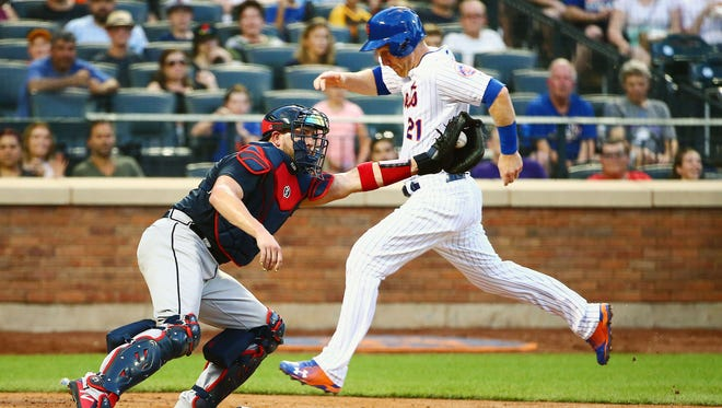 Aug 4, 2018; New York City, NY, USA;New York Mets third baseman Todd Frazier (21) scores on an infield out against the Atlanta Braves during the second inning at Citi Field.