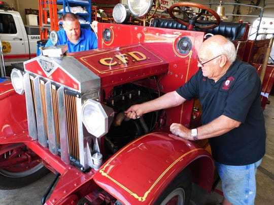 Gary Ross, right, checks over the engine of near century old 1920 Clydesdale fire engine. Clyde Fire Chief Craig Davis is left. Ross, a retired Clyde firefighter, and other volunteers with the Clyde Fire Department, are working on the Clydesdale and a 1928 Ford fire engine to prepare them to be in the June 18 NOVFA Parade in Green Springs. Ross said the Clydesdale will be ready but not sure if the Ford would be running properly in a week.