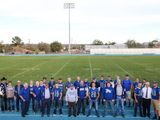 Snowflake football players pose with their fathers