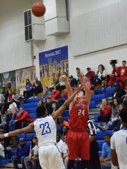 Riverheads' Grant Painter shoots a 3-pointer over Cumberland's