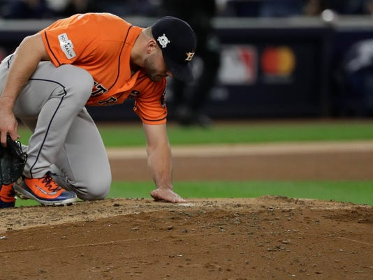 Houston Astros starting pitcher Lance McCullers Jr. looks over the mound after breaking a diamond necklace during the fourth inning of Game 4 of baseball's American League Championship Series New York Yankees Tuesday, Oct. 17, 2017, in New York. (AP Photo/David J. Phillip)