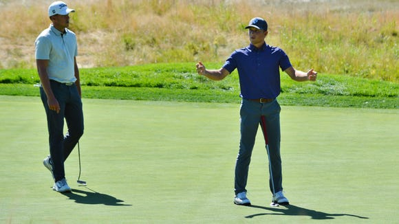Christian Cavaliere reacts after his putt for par on the 16th hole slides by the hole.