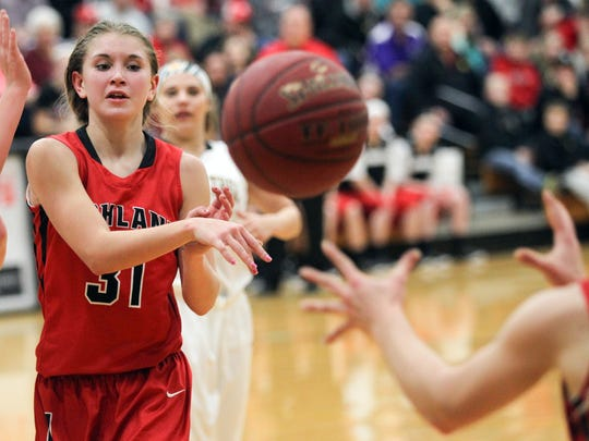Highland's Alison Stokes passes to a teammate during the Huskies' game in Lone Tree on Tuesday, Dec. 15, 2015.
