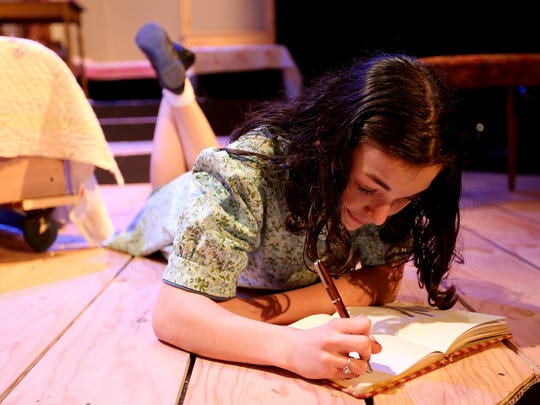 "Emma Bucher, as Anne Frank, stars in ""The Diary of Anne Frank"" at the Pentacle Theatre. The show runs through March 26. Bucher, 15, is a student at Dallas High School."