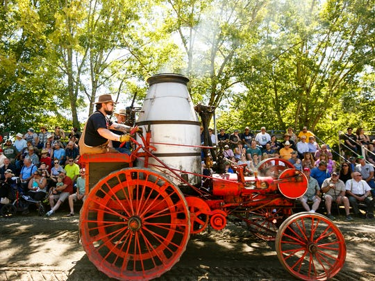 Crowds watch as a Westinghouse steam traction engine comes through the Parade of Power at the 46th annual Great Oregon Steam-Up on Sunday, July 31, 2016, at Antique Powerland.