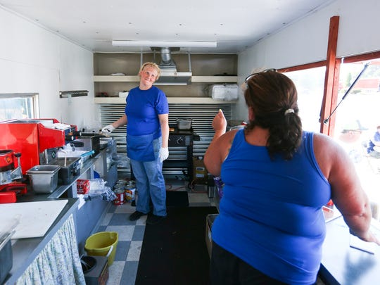 Hiedi Davis (left) talks to Ginger Murphy (right) as the two run the BB Cafe food truck during a soft opening on Friday, Aug. 5, 2016. Murphy, the truck's owner, is reopening the Blueberry Cafe in food truck form after the original restaurant was closed in 2002. Davis and her husband Michael will be running the daily operations of the truck.