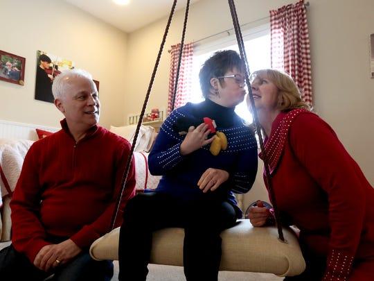 Khrizma Kuhn, 34, gives her mom, Renee Kuhn, a kiss